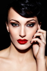 sexy model with bright makeup,with red lips and clean skin