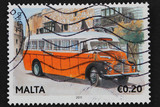 Malta 2011: stamp shows classic yellow Maltese bus