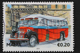 Malta: circa 2011: stamp shows image of classic red Maltese bus