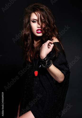 glamor stylish brunette model in black cloth with bright makeup