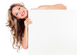 Beautiful young woman with long hair holding white board.