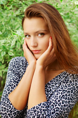 Portrait of young beautiful redhead woman