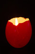 Red egg shell used as a candle holder
