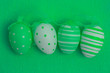 Four green easter eggs