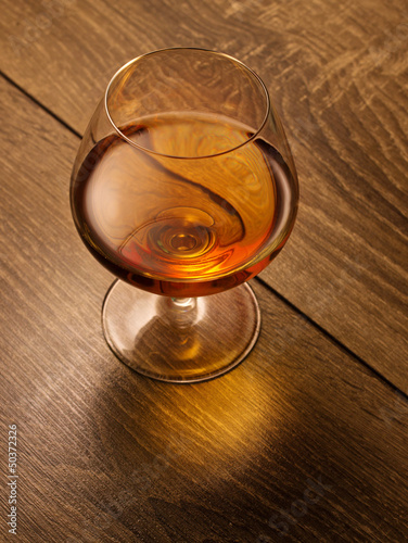 brandy glass on a wooden table