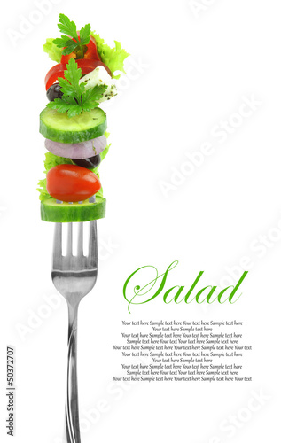 Fresh mixed vegetables on fork