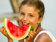 Summer joy, lovely girl eating watermelon