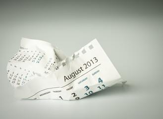 August. Crumpled calendar sheet