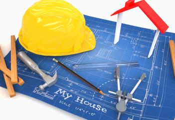Plano de casa con casco,lápiz,compás