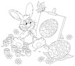 Easter Bunny drawing a decorated Easter egg