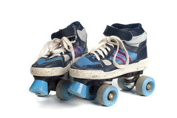 old blue rollerblades isolated on white background