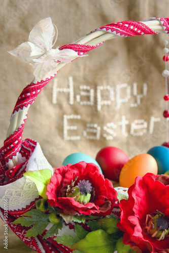 'Happy Easter' and basket with eggs, poppies and butterfly