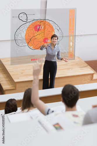 Teacher in front of futuristic interface pointing student