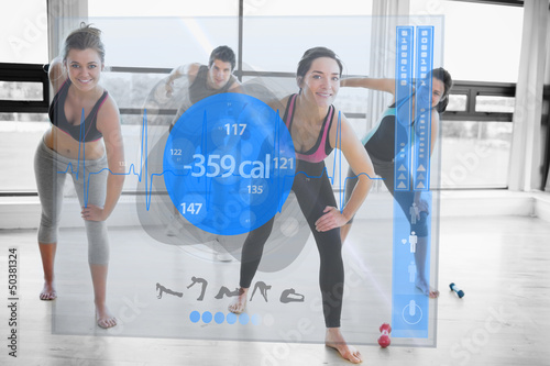 Women doing exercises with trainer while looking futuristic inte