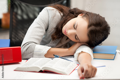 bored and tired woman sleeping on the table