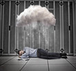Data worker napping under cloud in data centre