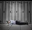 Data worker asleep on floor