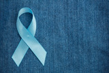 Blue ribbon for prostate cancer awareness on demin with copyspac