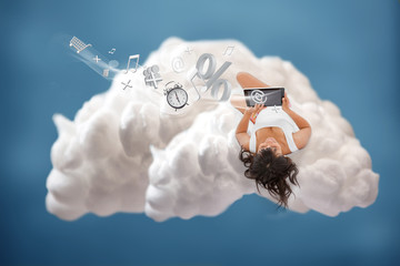 Brunette girl connected to cloud computing