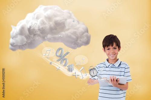 Cute boy using tablet to connect to cloud computing