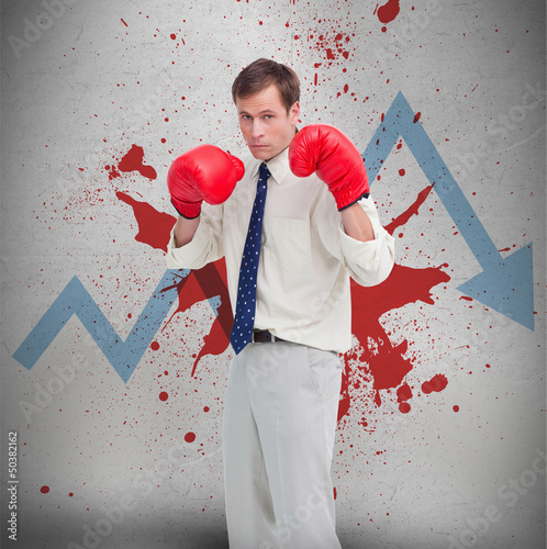 Businessman in boxing gloves against loss arrow and blood spatte