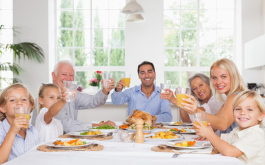 Happy family toasting at thanksgiving dinner