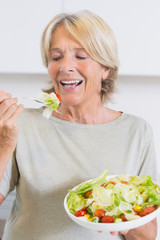Mature woman eating salad