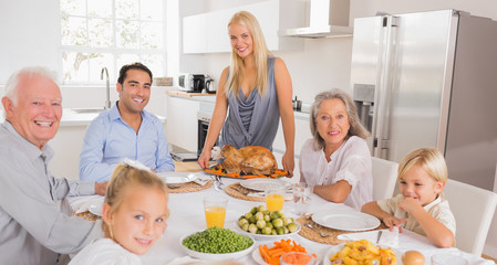 Happy mother serving a turkey