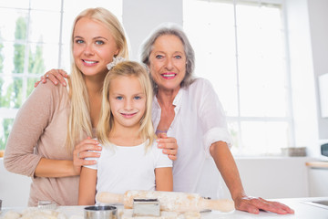 Cheerful mothers and daughters cooking together