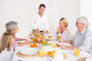 Man cutting slices of turkey