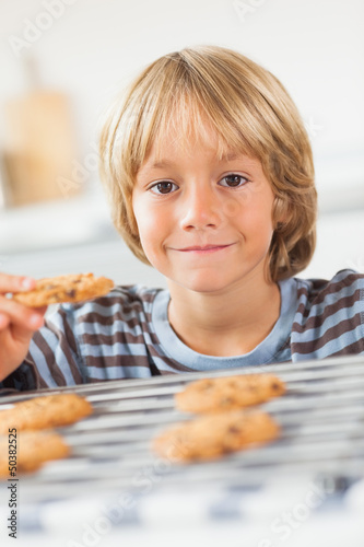 Smiling boy holding a cookie