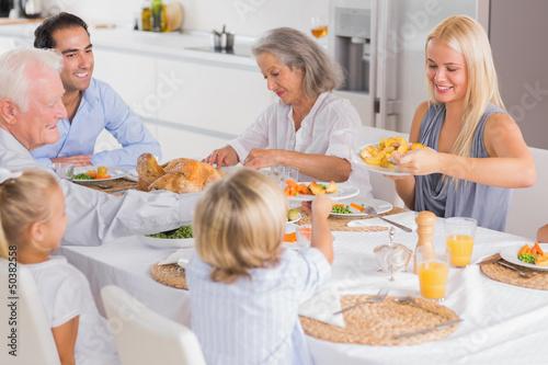 Happy Family eating the thanksgiving dinner