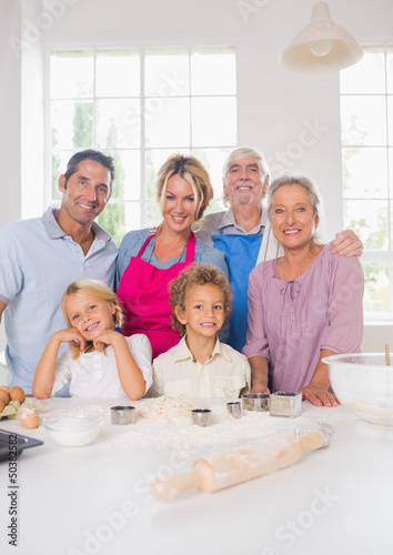 Smiling family preparing to cook