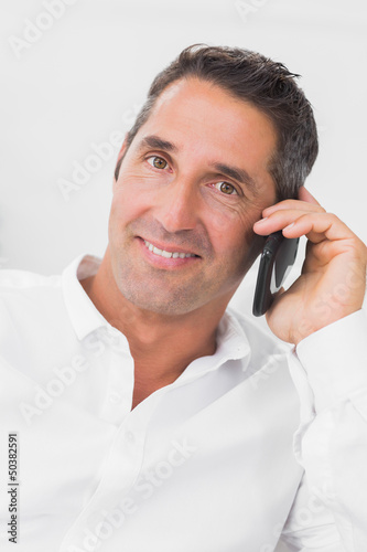 Man looking happy and talking on the phone