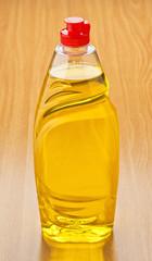 plastic bottle with liquid soap on wood base