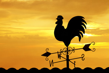 Weather Vane in Colorful Sky
