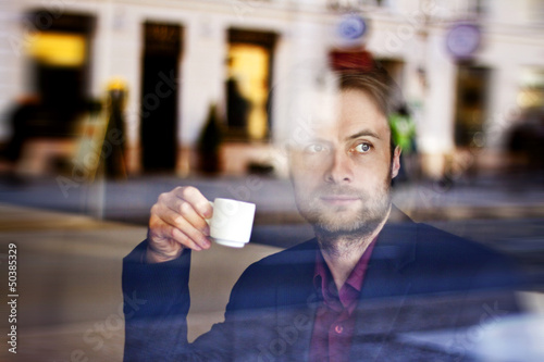 Businessman drinking espresso coffee in the city