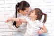 Mum gently kisses his daughter