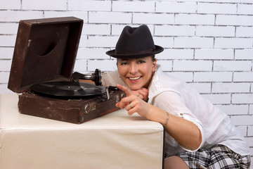 woman in a hat listening to records