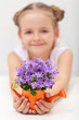 Happy child with spring flowers