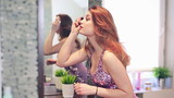 Young beautiful woman dyes her eyelashes before party