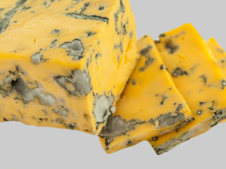 macro yellow dor blue cheese isolated on grey background