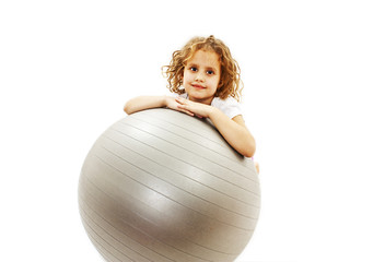 Adorable little girl with pilates ball on white background