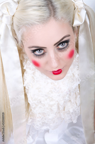 Girl with dolly makeup and blue eyes