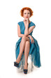 Retro readhead in vintage blue dress