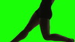 Silhouette of a Young woman dancing in of green screen.