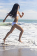 Sexy Woman Girl in Bikini Running on Beach
