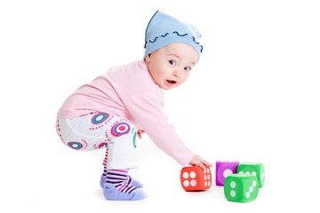 Funny little kid playing with cup toys