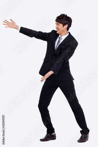 Young Asian business man showing something