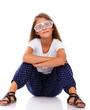 Stylish little girl in modern glasses